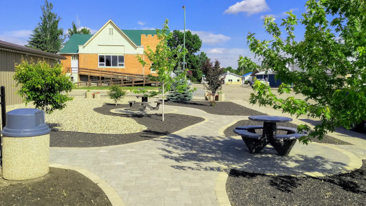 Small park space with picnic tables in Oxbow, SK.