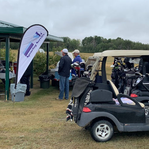 Golf carts parked at rain shelter.